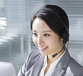 Chinese businesswoman working in office with headset